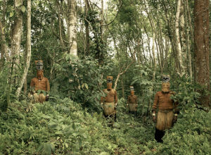 Guardians-of-the-Forest-Deep-in-the-Colombian-Amazon-Yucuna-indians-stand-dressed-in-traditional-tribal-attire-for-the-Baile-del-Mu  Eco-or-puppet-dance-a-celebration-of-the-abundance-of-the-Chontaduro-fruit.-While-traditiona